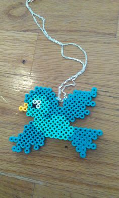Perler Bead Bird Necklace by RewrittenTime on Etsy You are in the right place about DIY Necklace rec Hama Beads Design, Diy Perler Beads, Perler Bead Art, Pearler Bead Patterns, Perler Patterns, 8bit Art, Motifs Perler, Peler Beads, Fusion Beads