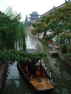 Zhujiajiao water town / China (by Dayou_X). Although it may b quite crowded in reality: http://www.travelchinaguide.com/attraction/shanghai/zhujiajiao.htm
