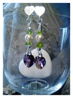 Check out this item in my Etsy shop https://www.etsy.com/uk/listing/244292751/purple-green-and-cream-earrings-maybe