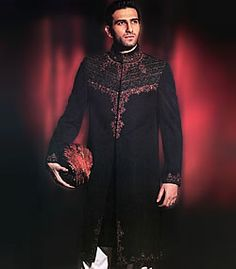 Black sherwani in raw silk fabric Elite quality embellishments on front, collar, bottom and sleeves Complimented with black kurta and offwhite shalwar