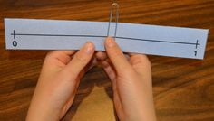 "Fraction Fun on a Number Line! Bridges First Edition Support - teaching fractions using a paperclip on a number line. Also a free ""I Have, Who Has"" game for fractions on a number line. 3rd Grade Fractions, Teaching Fractions, Fourth Grade Math, Math Fractions, Teaching Math, Maths, Equivalent Fractions, Math Teacher, Math Classroom"