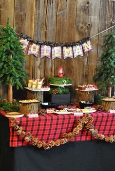 "Lumberjack Theme Party Ideas-- make some of that garland, little pine trees etc from your Christmas stash do double duty! This could also be a camping, hunting or other ""outdoors-y"" therme part."