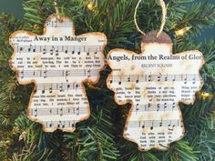 Celebrate the Christmas season with these rustic Christmas music ornaments!  LISTING INCLUDES - Two (2) wooden stained ornaments  FEATURES - Each ornament is about 4 1/2 H x 3 3/4 W - Each ornament is the shape of an angel - Each ornament has the sheet music to the hymn Away In a Manger and Angels, From The Realms of Glory on the front - Each ornament is sealed to protect it - Each ornament has a twine hanger  SHIPPING These items will be shipped within 1 to 2 business days upon rec...