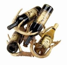 Reindeer horns cut out and attached to one another to support wine bottles at different levels and angles