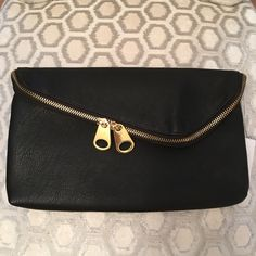 Black Gold Double Zip Clutch Bag Man made.  Snap closure and double zip closure.  Interior pocket.  Man made.  Measures: 11.25x1x6.75. Independent Designer Bags Clutches & Wristlets