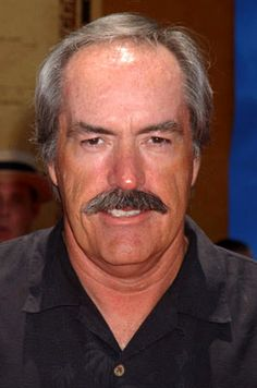 Like a younger powers boothe, but still with that sweet, sweet stache