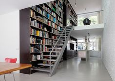 bookcases and stairs, Vertical Loft house with three-storey by Shift