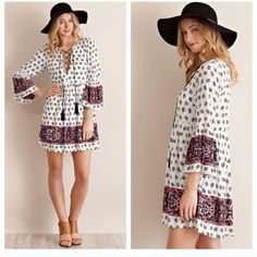 Baby doll dress Printed baby doll dress featuring bell sleeve and lace up front ties. 100% rayon Dresses Long Sleeve