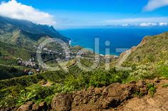 Qdiz Stock Photos | Mountain and clouds with village,  #background #blue #Canary #City #cloud #green #horizon #island #landscape #mountain #nature #ocean #road #rock #scenic #sea #sky #Spain #spring #Tenerife #town #view #village