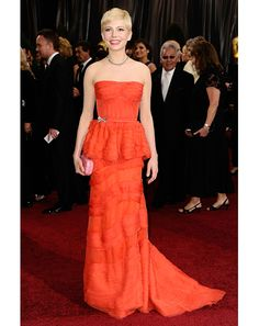 Michelle WIlliams looking stunning on the Red Carpet in a red Louis Vuitton.
