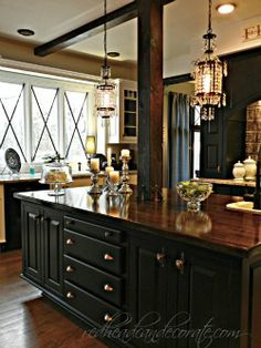 Redhead Can Decorate - gorgeous kitchen. Love the light fixtures, countertop, cabinets.