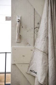 Hand stitched natural linen towel, made from panelled antique Swedish linen. Decoratively stitched using flax twine.