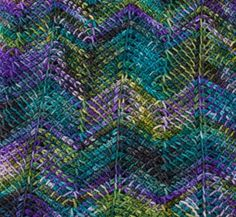 Get tips on a variety of Tunisian crochet stitches, including this chevron.
