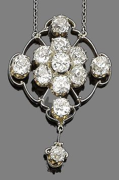 A diamond pendant, circa 1910  The lozenge-shaped pendant, set throughout with old brilliant-cut diamonds, within a knife-edge openwork frame, suspending an old brilliant-cut diamond drop, mounted in platinum and gold, on a trace-link chain, diamonds approx. 5.50cts total, pendant length 4.2cm, chain length 47.5cm, fitted case by H. W. Cave, 120 Parade, Leamington