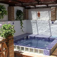Create your own little slice of heaven with one of our DIY spas. Rich blue tiles and hanging plants will help turn your yard into a private oasis. #modernhome #homerenovation #currentdesignsituation #hottub #Jacuzzi #sauna #ideas #diy #projects #easy #diyproject #customspa #diyspa #spa #diyhome #landscapedesign #instahome #outside #inspo