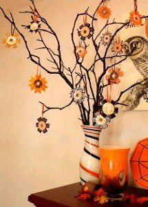 Instructions to make ribbon flowers.  I also like the vase these branches are planted in.