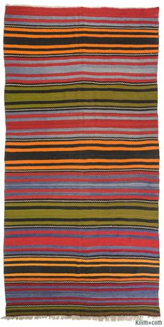 Vintage Turkish kilim rug hand-woven in 1960's. This striped kilim is in very good condition.