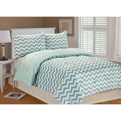Dress your bed with this gorgeous three-piece comforter set. Made of comfortable and velvety polyester microplush fabric, this comforter set offers irresistible softness and naturally resists stains and dust. The set also includes two decorative shams.
