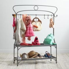 They say you should dress for the job you want.  So for all those kids who want to be astronauts or princesses or tigers or wizards, the functional shelves and hooks of our Dress Up for Success Wardrobe Rack keep all your outfits in one place.  It features a stylish, vintage-inspired design and a sleek metal construction that's ideal for busy, professional dresser uppers on-the-move.