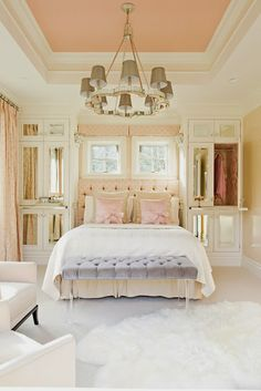 Love the pink ceiling, soft pink taffeta curtains,and storage closets w pull out shelf