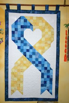 Down Syndrome Awareness ribbon.  5-2014 I designed and quilted it myself.