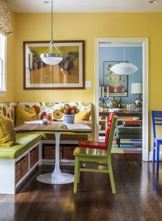 I like the banquette and table idea, very space saving. Houzz: It's hard to imagine a boring meal in this dining nook. I love how the soft, warm yellow wall and bright banquette recall a farmhouse, while the Saarinen-style table base and nearby George Nelson lamp bring everything up-to-date.