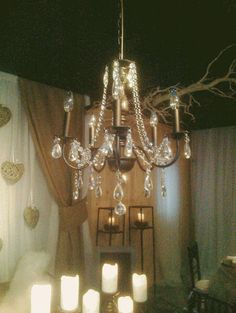 Accent your Wedding with this gorgeous Crystal Chandelier. Come in to The Little Flower Shop Studio today!