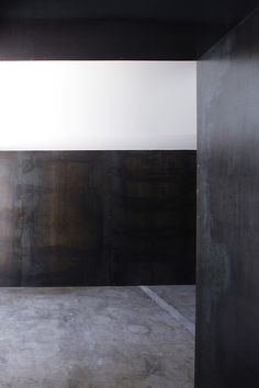 Steel walls + concrete floor.