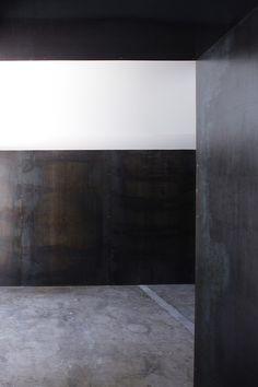 Steel walls + concrete floor.