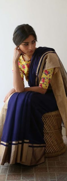 Bright floral blouse with a stark navy sari - great combo! Raw Mango Collection -  original pin by @webjournal