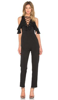 Compra Lavish Alice Lace Up Jumpsuit en Negro en REVOLVE. Envío y devoluciones de 2-3 días gratis y 30 días de garantía de igualación de precio.