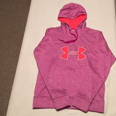 Women's Under Armour Storm Hoodie - Size M Super Warm Women's Under Armour Storm Hoodie - Size M.  Soft brushed inner layer traps in heat for all day warmth and comfort.  Signature Storm Moisture Transport System wicks swear to keep you dry and light.  Stylish Rebel Purple color with Pink Logo.  In Great Condition. Under Armour Tops Sweatshirts & Hoodies