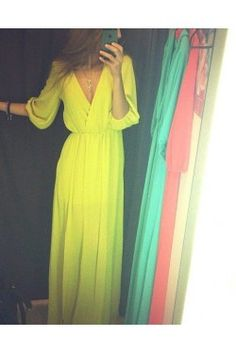 This neon yellow maxi dress is sure to turn heads with 3/4 length sleeves, a surplice bodice and a flattering gathered waist. Add a little glam to your goddess ways with a slit on the front, bottom side of the maxi.