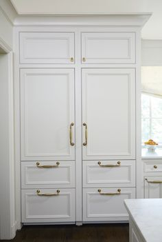 """The SubZero refrigerator and freezer are beautifully integrated behind custom cabinet doors,"" says Cyndy. ""Using brass pulls is so much prettier than refrigeration of the past."" This is Cantley Inset Cabinets, Custom Kitchen Cabinets, Kitchen Cabinet Doors, Pantry Doors, Cabinet Hardware, Custom Cabinet Doors, Cabinet Door Styles, Refrigerator Panels, Subzero Refrigerator"