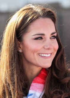 Catherine, Duchess of Cambridge smiles as she wears the Team GB Official Supporter's Scarf for London 2012 before meeting the GB HockeyTeam at the Riverside Arena in the Olympic Park on March 15, 2012 in London.