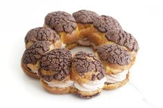 This is Paris Brest, which is a traditional French dessert made of choux pastry that is drizzled in a round shape and filled with cream. This version has a chocolate crumble layer on top of the pastry and is filled with coffee …
