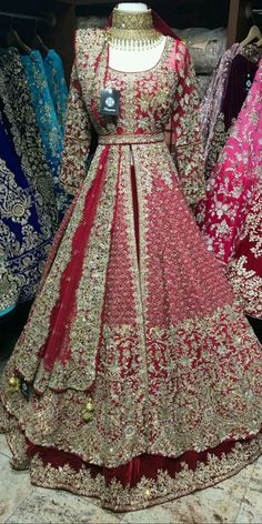 Maroon Bridal Lacha - Maroon velvet skirt and raw silk jacket with gold crystals , zardosi and sequin embroidery Lacha Fabric – Velvet , Raw silk Jacket – Chest , Length 60 Skirt – waist , length Source by - Asian Bridal Dresses, Asian Wedding Dress, Indian Bridal Outfits, Indian Gowns Dresses, Pakistani Wedding Outfits, Indian Bridal Wear, Pakistani Wedding Dresses, Indian Designer Outfits, Pakistani Gowns