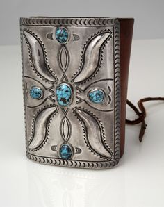 Navajo Wrought Ketoh: Strength, balance and symmetry combines with grace in this ketoh made of a rectangular piece of heavy sheet silver; stamped and repousse designs. Turquoise is high quality, medium blue, with reddish-brown matrix. Ca. 1900. Photo by Jannelle Weakly, from the permanent collections of Arizona State Museum.