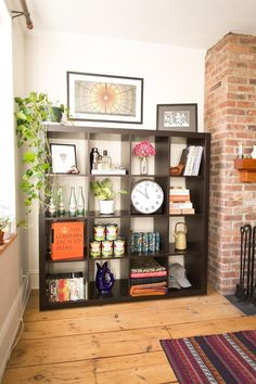 Nobody said you had to hang a clock on a wall, or that you need a bar cart for your liquor.