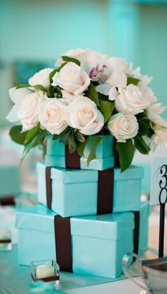 Tiffany Blue and Brown Wedding Centerpieces: Tiffany Blue Boxes with Brown Ribbon topped with White Roses surrounded by white tea light candles. Tiffany Blue Party, Tiffany Theme, Tiffany Wedding, Tiffany And Co, Tiffany Blue Centerpieces, Wedding Centerpieces, Wedding Decorations, Wedding Ideas, Wedding Pictures