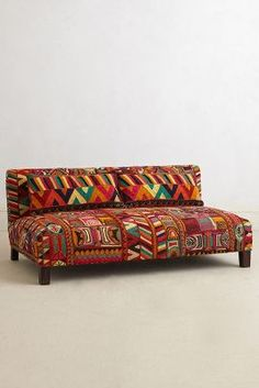 Hand-embroidered sofa. Love the pattern! You'll love our Rwenzori Trading…