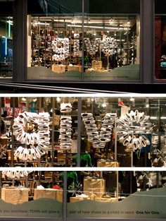 The Power of Advertising: With TOMS Shoes's popularity growing, window displays are becoming more and more creative. These displays showcase what TOMS Shoes are all about, in this case, giving. These displays make shoppers stop and think... and buy.