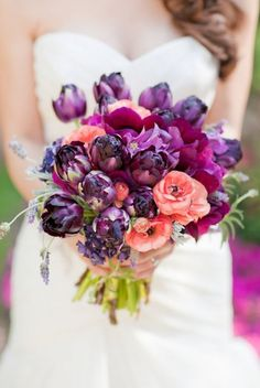 Love the shades of purple, magenta and peach in this gorgeous wedding bouquet.