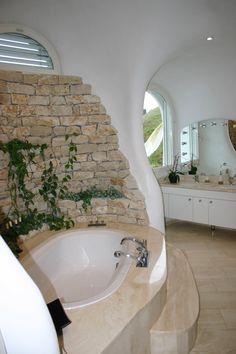 Peter Vetsch's Earth House... in Switzerland.   Energy Saving Eco Friendly....I like the bathtub.