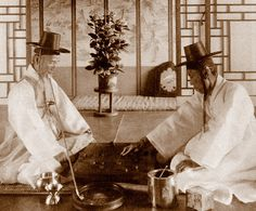 OLD KOREA - LAND OF THE MORNING CALM -- Two High-Class Gentlemen playing a game.     Photo by HERBERT G. PONTING, 1903.