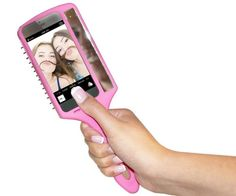 Feed your inner narcissist with the Selfie Brush, a hair brush, iPhone case and mirror.