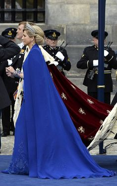 Dutch King Willem-Alexander and his wife Queen Maxima leave Nieuwe Kerk church.   I just love Máxima's cape in Sapphire blue to match the MELLERIO Sapphire Tiara.