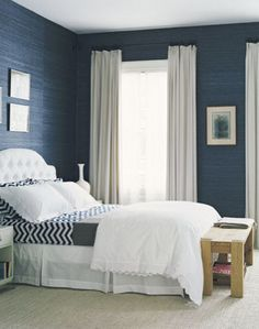 blue grasscloth in a bedroom