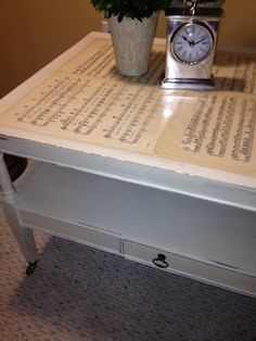 Hmm, maybe old love letters. Antique sheet music Mod Podged onto coffee table   -The Elegant House