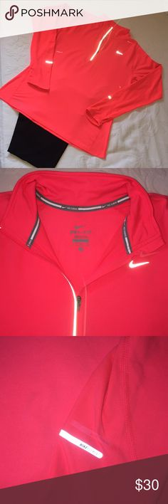 Nike Dry Fit quarter zip Nike dry fit running quarter zip in perfect condition. The color is a very vibrant almost glowing deep coral with pink and orange tones. Pic 3 is a good representation of the color. Size medium is true to size with thumb holes in sleeve and nice reflective accents. 89% polyester 11% spandex.  Smoke free home Nike Tops Sweatshirts & Hoodies